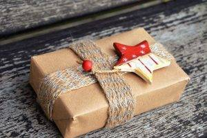 Christmas gift wrapped in brown paper with star ornament