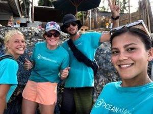 ocean mimic volunteers cleaning beaches