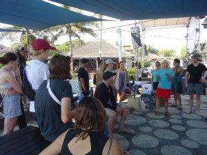 Group of volunteers listening to a beach clean up briefing