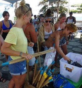 volunteers collecting equipment e.g. tongs