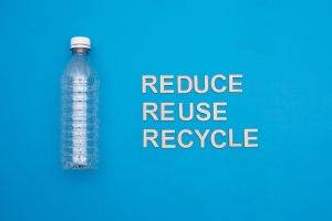 plastic bottle and text reduce, reuse, recycle