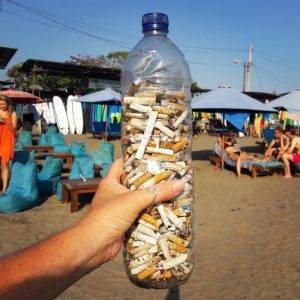 bottle full of cigarette butts