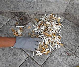 Hand sorting cigarette butts