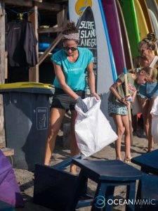 Volunteer picking up rubbish on beach