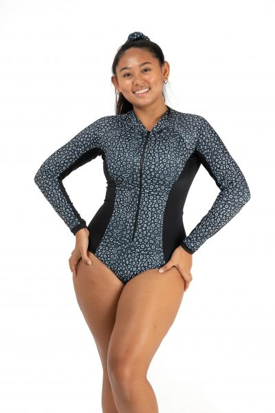 woman wearing the spotted eagle ray body suit